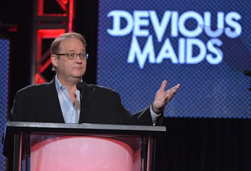 "FILE - In a Thursday, Jan. 9, 2014 file photo, creator and executive producer Marc Cherry speaks on stage at the Lifetime/A&E Winter Press Tour, in Pasadena, Calif. Cherry and Damon Lindelof, creators of two of the most indelible dramas on network television last decade, ""Lost"" and ""Desperate Housewives,"" are making programs for cable networks now. Once often content to air reruns, cable networks are busy establishing themselves as creators. (Photo by John Shearer/Invision for A&E Networks/AP Images, File)"