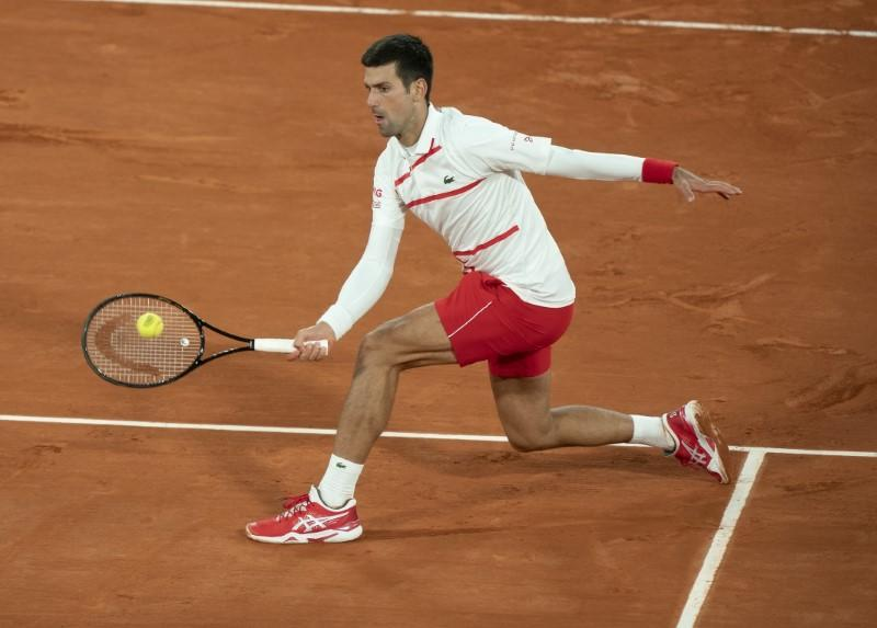 Djokovic survives scare to beat Carreno Busta