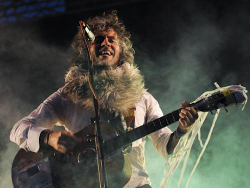 FILE - This June 8, 2012 file photo shows Wayne Coyne, the lead singer and guitarist of American band The Flaming Lips during the Optimus Primavera Sound music festival in Porto, Portugal. (AP Photo/Paulo Duarte) EDITORIAL USE ONLY