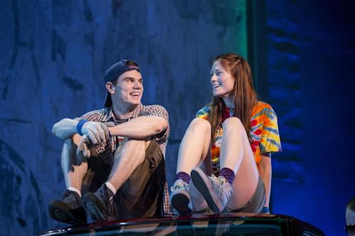 """This theater image released by The Hartman Group shows Jay Armstrong Johnson, left, and Allison Case during a performance of """"Hands on a Hard Body,"""" at the Brooks Atkinson Theater in New York and featuring songs co-written by Phish frontman Trey Anastasio. (AP Photo/The Hartman Group, Chad Batka)"""