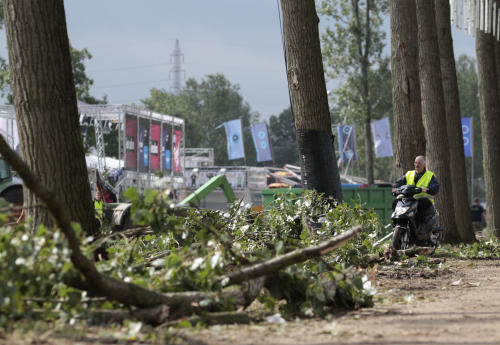 A man looks at the damage at the festival campsite near Hasselt, 50 miles (80 kilometers) east of Brussels, Friday Aug.19, 2011. Five people died in a fierce thunderstorm on Thursday, that mangled tents and downed trees and scaffolding at the open-air music festival PukkelPop in Belgium. Organizers canceled the annual four-day festival. (AP Photo/Yves Logghe)