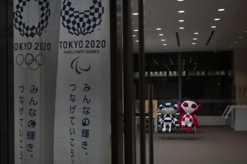 "Miraitowa and Someity, mascots for the Tokyo 2020 Olympics and Paralympics are seen in Tokyo, Tuesday, March 24, 2020. IOC President Thomas Bach has agreed ""100%"" to a proposal of postponing the Tokyo Olympics for about one year until 2021 because of the coronavirus outbreak, Japanese Prime Minister Shinzo Abe said Tuesday. (AP Photo/Jae C. Hong)"