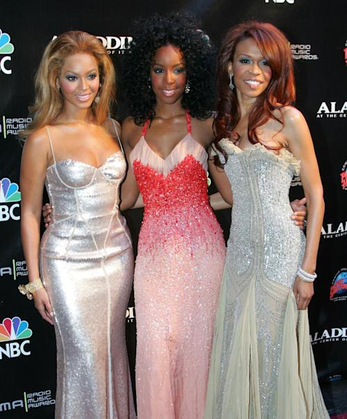 FILE - This Oct. 25, 2004 file photo shows members of Destiny's Child, from left, Beyonce Knowles, Kelly Rowland and Michelle Williams at the Radio Music Awards in Las Vegas. The singer-actress _ one third of Destiny's Child alongside Beyonce and Kelly Rowland _ said that in the past few months she has emerged from years of suffering from moderate depression. Her dark cloud lifted thanks to exercise, therapy and positive thinking. (AP Photo/Eric Jamison, file)