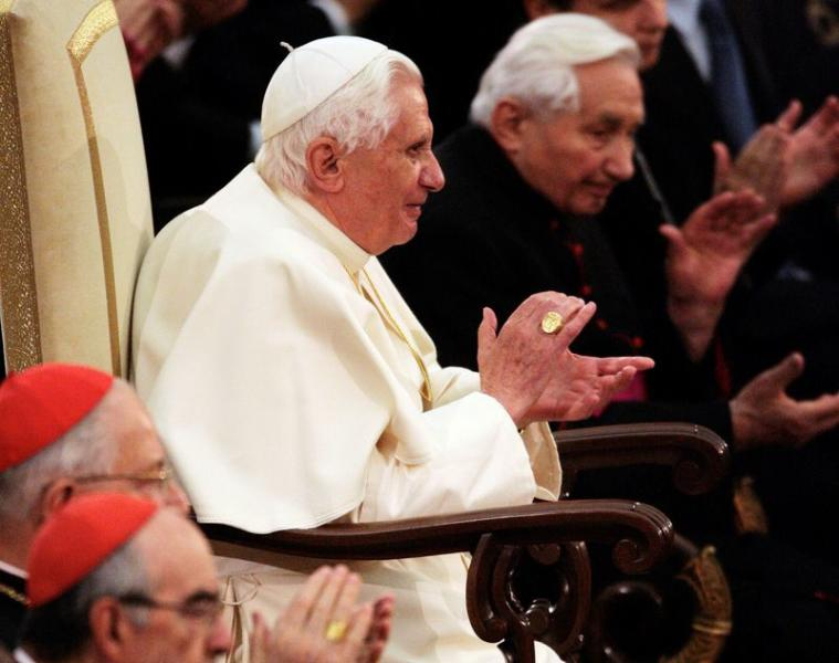 FILE PHOTO: Pope Benedict XVI and his brother, Bishop Ratzinger, applaud a classical music concert by Bayerischer Rundfunk at the Vatican