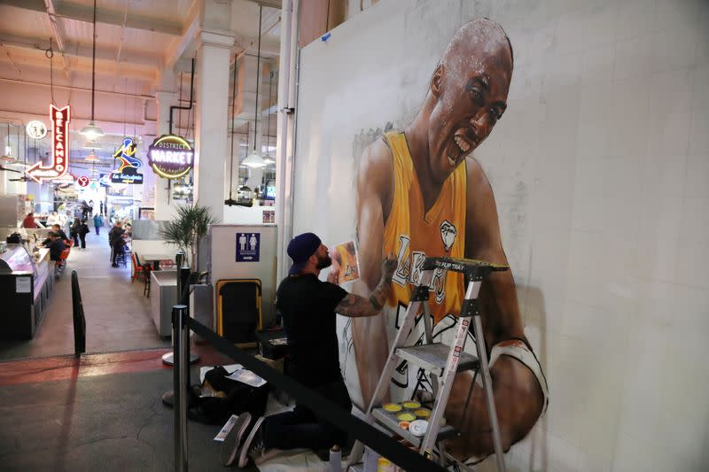 Muralist Jonas Never paints a portrait of late retired basketball player Kobe Bryant in Los Angeles