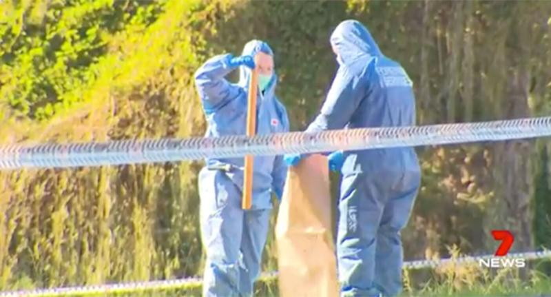 Forensic investigators are seen removing a metal pole and a golf club from an Ingleburn park at believed to be used in a fight that killed 18-year-old Alex Ioane.