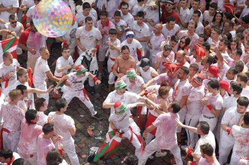 Fisticuffs break out as participants prepare for the startof the bull run, whose reputation has recently been deeply soured by cases of sexual violence