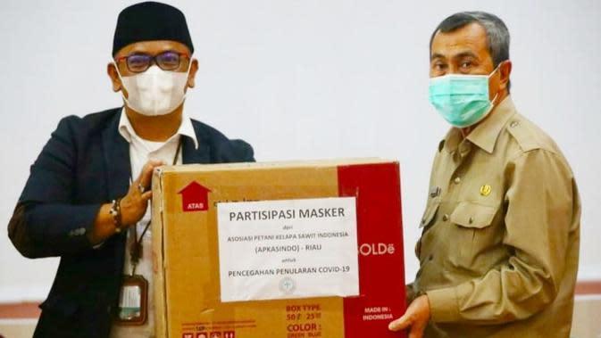 Petani Sawit Patungan Sumbang Masker Cegah Lonjakan Covid-19 di Riau