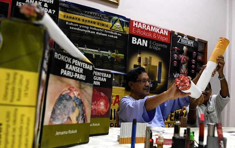A CAP education officer during a press conference on May 30. — Bernama pic