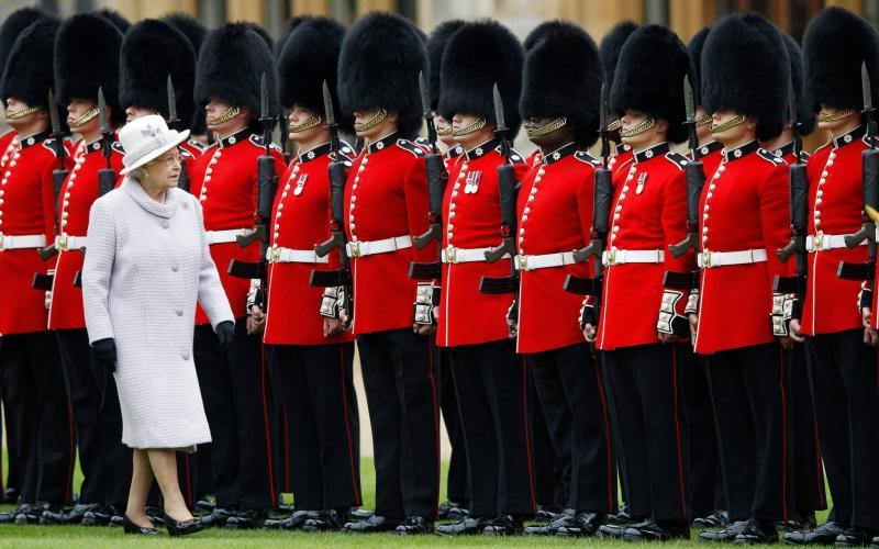 The Queen's guard wear bearskin hats - Getty
