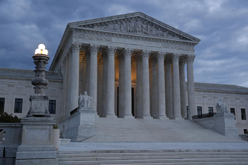 FILE - In this May 3, 2020, file photo, clouds roll over the Supreme Court at dusk on Capitol Hill in Washington. Trump is hoping to persuade a Supreme Court with two of his appointees to keep his tax and other financial records from being turned over to lawmakers and a New York district attorney. The justices are hearing arguments by telephone Tuesday, May 12. (AP Photo/Patrick Semansky, File)