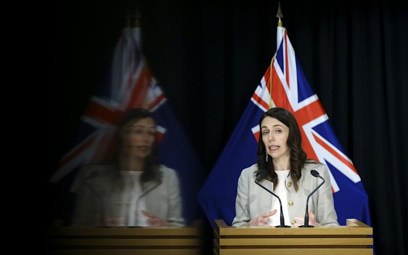 New Zealand Premier Jacinda Ardern tells the country at a press conference that containment measures against a new outbreak of coronavirus in Auckland will stay in place for another 12 days - Hagen Hopkins/Getty Images