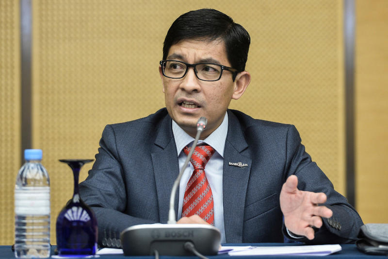 Bank Islam CEO Mohd Muazzam Mohamed said banks have even asked for Islamic religious authorities' help, such as having mosques in eight states and territories deliver Friday sermons on financial management. — Picture by Miera Zulyana