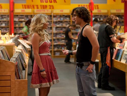 "This film image released by Warner Bros. Pictures shows Julianne Hough as Sherrie Christian, left, and Diego Boneta as Drew Boley in New Line Cinema's rock musical ""Rock of Ages,"" a Warner Bros. Pictures release. (AP Photo/Warner Bros. Pictures, David James)"