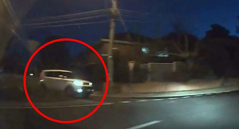 The white car approaches the roundabout. Source: Dash Cam Owners Australia/ Facebook