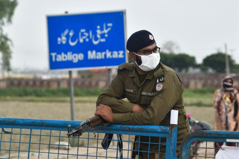 A Pakistani policeman at a checkpoint in Lahore, where the Islamic missionary movement gathered