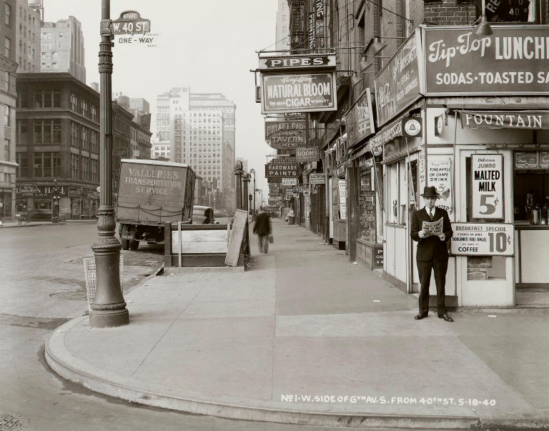 "In this May 18, 1940 photo provided by the New York City Municipal Archives, a man reads a newspaper on New York's 6th Ave. and 40th St, with the headline: ""Nazi Army Now 75 Miles From Paris."" Over 870,000 photos from an archive that exceeds 2.2 million images have been scanned and made available online, for the first time giving a global audience a view of this rich collection that documents life in New York City.  (AP Photo/New York City Municipal Archives, Borough President Manhattan) MANDATORY CREDIT"