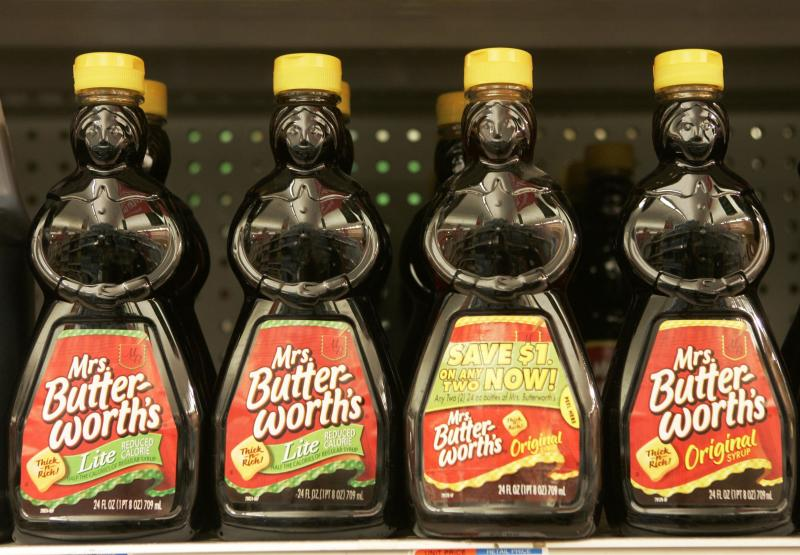 "FILE - In this Nov. 20, 2007 file photo, bottles of Mrs. Butterworth's syrup are displayed on a supermarket shelf in Basking Ridge, N.J. Mrs. Butterworth  and Cream of Wheat are the latest brands reckoning with racially charged logos. Chicago-based Conagra Brands, which makes Mrs. Butterworth's syrup, said its female-shaped bottles are intended to evoke a ""loving grandmother."" But the company said it can understand that the packaging could be misinterpreted.  The soul-searching comes in the wake of PepsiCo's announcement Wednesday, June 17, 2020, that it's renaming its Aunt Jemima syrup brand. (AP Photo/Mike Derer, File)"