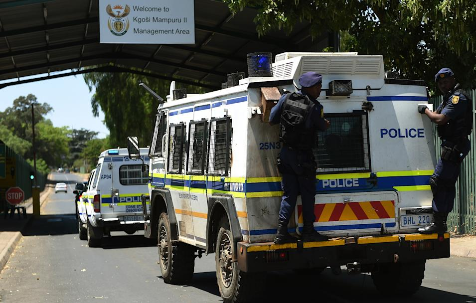 A vehicle believed to be transporting Oscar Pistorius arrives at the Kgosi Mampuru Correctional Services prison in Pretoria, South Africa, Tuesday, Oct. 21, 2014. Pistorius was sentenced to five years imprisonment by judge Thokozile Masipais for killing his girlfriend Reeva Steenkamp last year. (AP Photo)