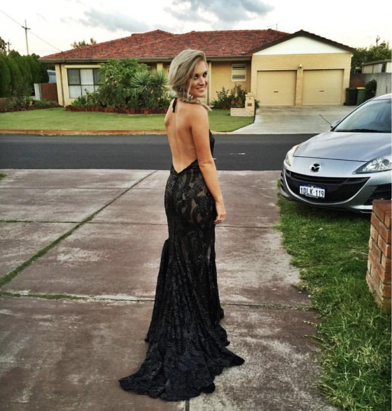 A photos shows Kayla Halnan in a black formal dress.