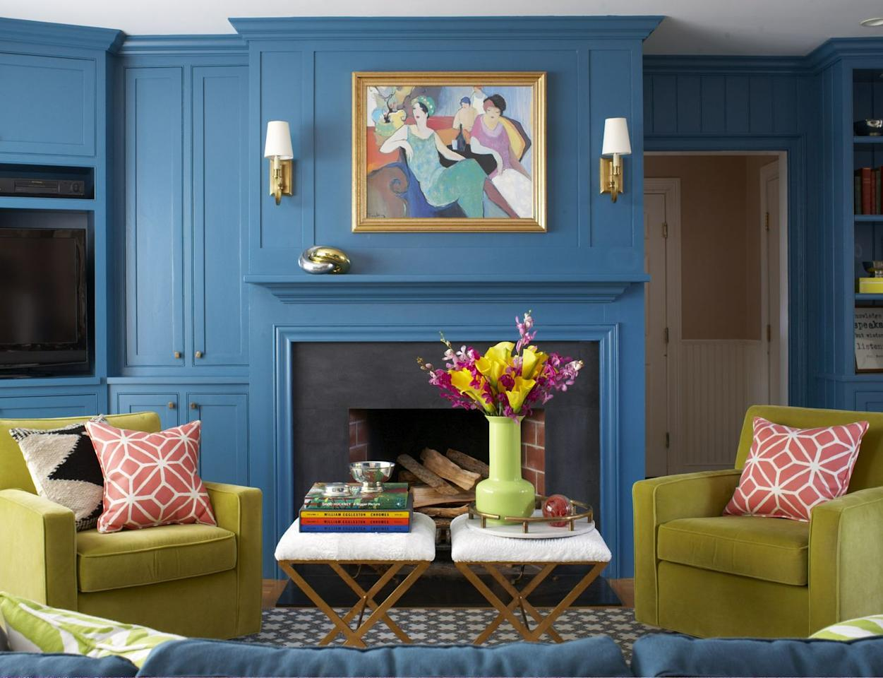 "<p>A deep, royal blue sets the tone for this family room from <a href=""https://deringhall.com/interior-designers/liz-caan-co"" target=""_parent"">Liz Caan & Co</a>.</p>"
