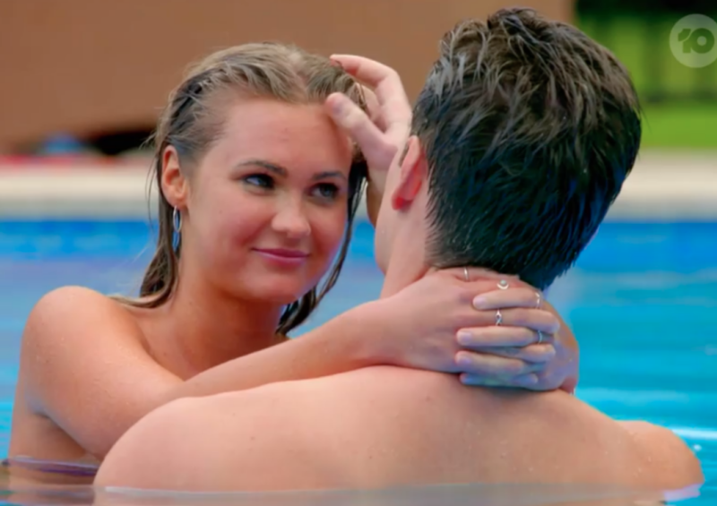 Chelsie McLeod puts her arm around Matt Agnew's neck in the pool