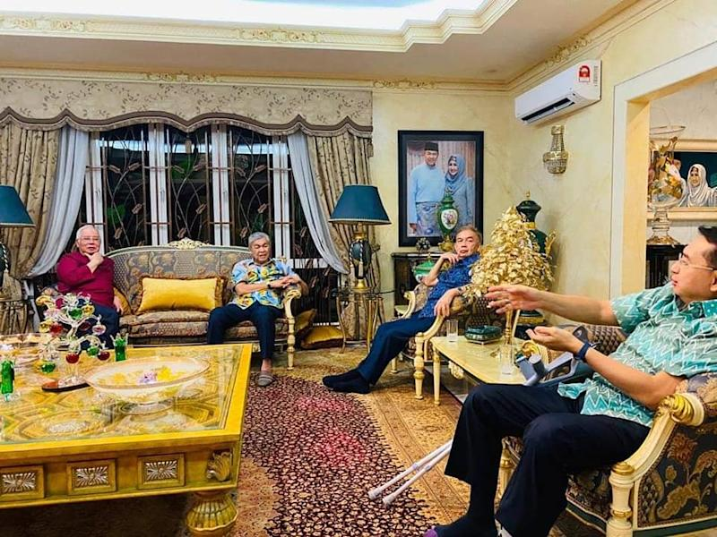 Datuk Seri Najib Razak (left) is pictured during a visit to Datuk Seri Ahmad Zahid Hamidi's (second from left) official residence. — Picture via Facebook