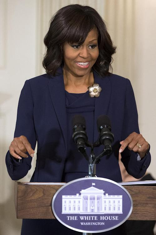 "First Lady Michelle Obama introduces a panel of the cast and crew of the movie ""42,"" Tuesday, April 2, 2013, in the State Dining Room of the White House in Washington. (AP Photo/Jacquelyn Martin)"