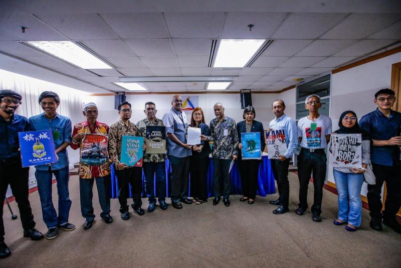 Penang Forum committee member, Khoo Salma Nasution, gives a copy of the Penang Tolak Tambak memorandum to Suhakam commissioner Jerald Joseph in Kuala Lumpur January 16, 2020. — Picture by Hari Anggara