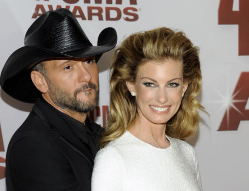 "FILE - This Nov. 9, 2011 file photo shows country singers Tim McGraw, left, and his wife Faith Hill at the 45th Annual CMA Awards in Nashville, Tenn. McGraw and Hill are brushing off divorce rumors as they power into a new round of ""Soul2Soul"" duet performances in Las Vegas. The country music royals sat close and joked with each other about tabloid headlines during a round table interview with reporters before their Friday Nov. 15, 2013, show at the Venetian casino. (AP Photo/Evan Agostini, file)"