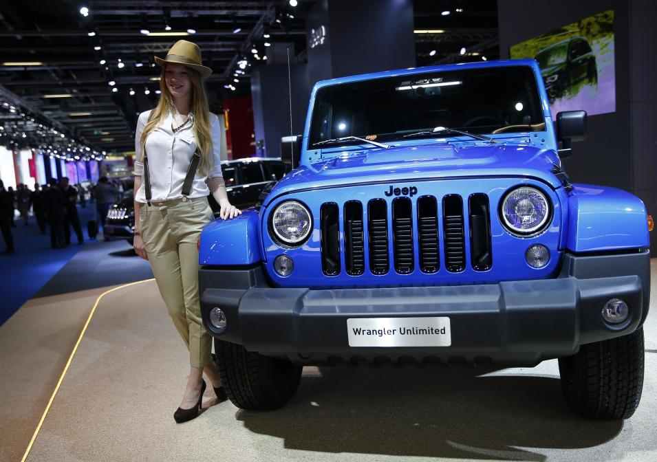 Model poses beside a Jeep Wrangler Unlimited vehicle at Frankfurt Motor Show