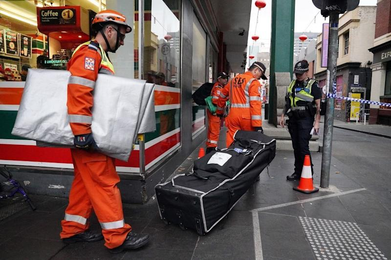 SES officers were seen at Chinatown Wednesday morning after the discovery of a woman's body. Source: AAP