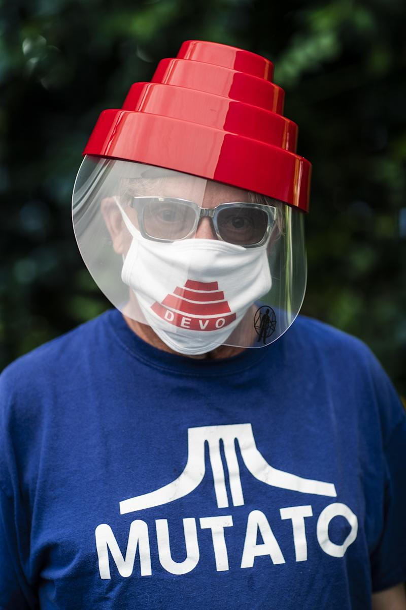 Mark Mothersbaugh survived Covid-19 and is recovering at home. He is photographed wearing official Devo ppe.