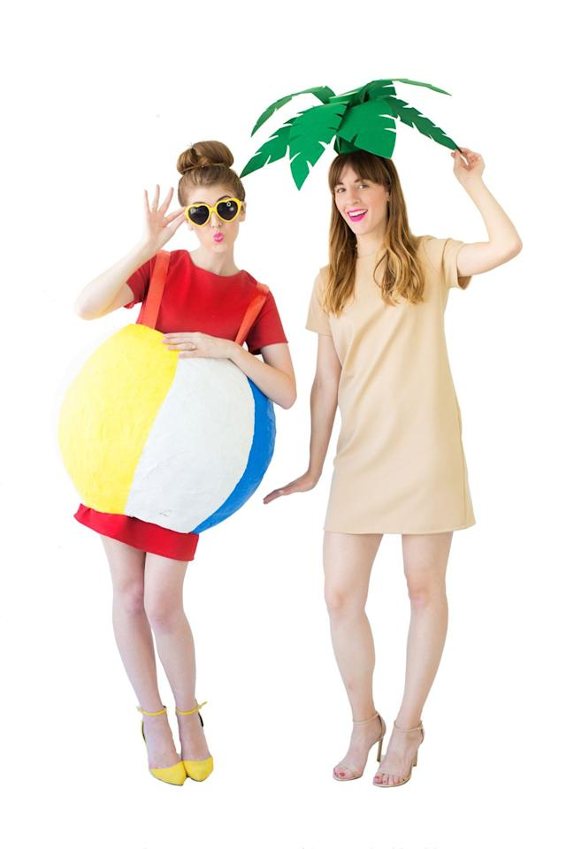 """<p>You and your sister go together like peanut butter and jelly, pencils and paper, beach balls and palm trees. This travel-inspired costume proves that point. </p><p><em><a href=""""https://studiodiy.com/diy-palm-tree-beach-ball-costumes/"""" target=""""_blank"""">Get the tutorial at Studio DIY »</a></em></p>"""