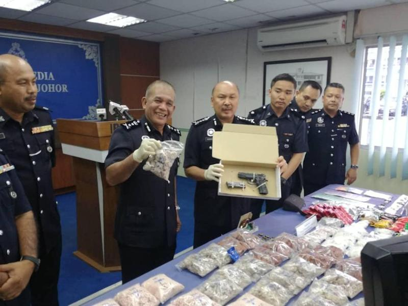 Johor police chief Datuk Mohd Kamarudin Md Din (centre) with the items seized from the drug trafficking syndicate in Johor Baru January 23, 2020. — Picture by Ben Tan