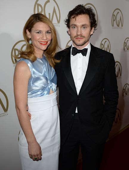 Claire Danes and Hugh Dancy arrive at the 25th annual Producers Guild of America (PGA) Awards at the Beverly Hilton Hotel on Sunday, Jan. 19, 2014, in Beverly Hills, Calif. (Photo by Jordan Strauss/Invision for Producers Guild/AP Images)