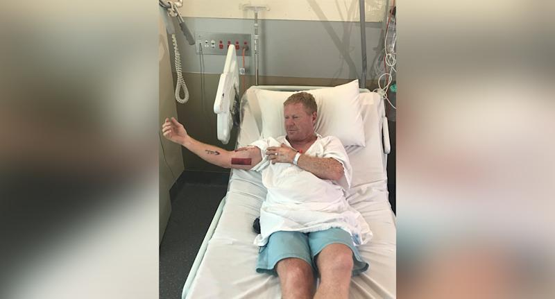 The man (pictured) punched a shark
