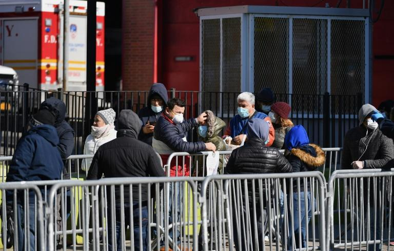New Yorkers queue outside Elmhurst Hospital Center in Queens to get tested for the coronavirus