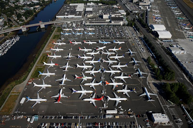 Grounded Boeing 737 MAX aircraft are seen parked in a storage lot and Boeing employee parking lot in an aerial photo at Boeing Field in Seattle, Washington, U.S. July 1, 2019. Picture taken July 1, 2019. REUTERS/Lindsey Wasson