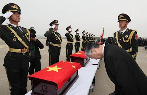 Chinese ambassador to South Korea Qiu Guohong bows to caskets containing the remains of 20 fallen Chinese soldiers covered by Chinese national flags during a handing over ceremony at the Incheon International Airport in South Korea in 2018. Photo: EPA-EFE