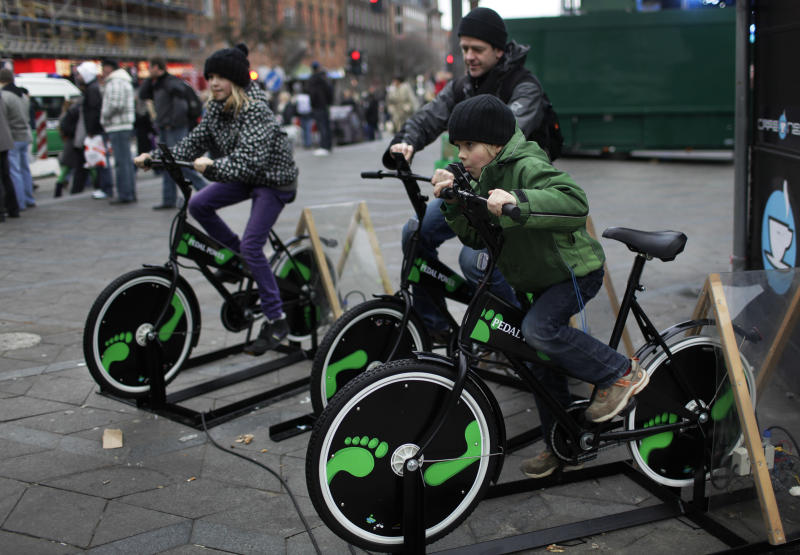 Danish people try out bicycles being set up to produce electricity in the center of Copenhagen, Denmark. | Anja Niedringhaus—AP