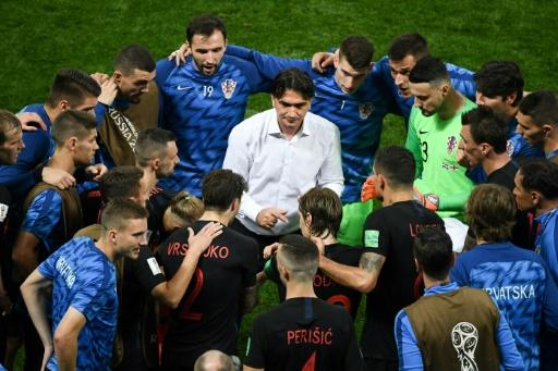 Zlatko Dalic talks to his players before extra-time against England