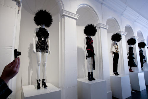 "A visitor photographs the Metropolitan Museum of Art's exhibit, ""Punk: Chaos to Couture,"" Monday, May 6, 2013 in New York. The show, which examines punk's impact on high fashion from the movement's birth in the 1970s through its continuing influence today, is open May 9 through August 14. (AP Photo/Mark Lennihan)"