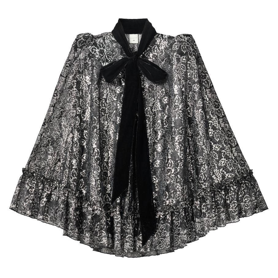 """<p>Silver lace cape, £24.99, H&M</p><p><a class=""""body-btn-link"""" href=""""https://go.redirectingat.com?id=127X1599956&url=https%3A%2F%2Fwww2.hm.com%2Fen_gb%2Flife%2Fculture%2Finside-h-m%2Fintroducing-the-vampires-wife-x-hm.html&sref=https%3A%2F%2Fwww.cosmopolitan.com%2Fuk%2Ffashion%2Fstyle%2Fg34287086%2Fhandm-the-vampires-wife%2F"""" target=""""_blank"""">READ MORE</a></p><p>A stand out piece from the collection, we've got our eye on this stunning lace cape.  </p>"""