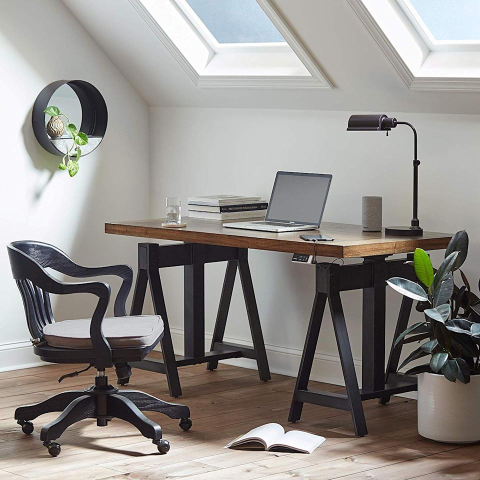 """<p>This year has been challenging in many ways, but creating that work/life balance has been a major hurdle for people who have found themselves working from home (or is it living at work? We can't tell). It's important to create a designated workspace to keep yourself organized and presentable for all of those <a href=""""https://www.countryliving.com/life/a32253855/country-living-zoom-backgrounds/"""" target=""""_blank"""">Zoom</a> calls. Trust us, work meetings from the comfort of your bed go against all of the <a href=""""https://www.countryliving.com/entertaining/a29234097/office-etiquette-rules/"""" target=""""_blank"""">office etiquette rules</a>. If you are unexpectedly having to create a workspace to make your work-from-home life a bit more comfortable, you may be in the market for a new desk to keep you on track. We've rounded up desks that are perfect for small spaces and will fit right in with your new <a href=""""https://www.countryliving.com/home-design/decorating-ideas/g31006400/home-office-decor-ideas/"""" target=""""_blank"""">home office decor</a>.</p><p>To make the situation more complicated, many working parents are now sharing office space with pint-size virtual students, who also need their own space. Because a <a href=""""https://www.countryliving.com/home-design/decorating-ideas/g28086218/kids-desk-study-table-ideas/"""" target=""""_blank"""">kid's desk</a> may not have been apart of your original design plan, there may not be much room for the new classroom. It might seem like a tall order to do it all, but we will certainly try.  The important thing to remember is that a small space does not mean compromising on beautiful design, so we've rounded up 15 space-saving desks that don't skimp on style.</p>"""