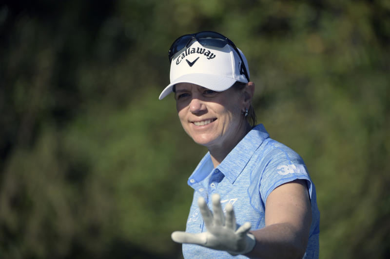 FILE - In this Dec. 7, 2019, file photo, Annika Sorenstam, of Sweden, waves to spectators after teeing off on the first hole during the first round of the Father Son Challenge golf tournament in Orlando, Fla. Sorenstam has started a fund to give $500 grants to 100 players on the LPGA's developmental Symetra Tour.  (AP Photo/Phelan M. Ebenhack, File)