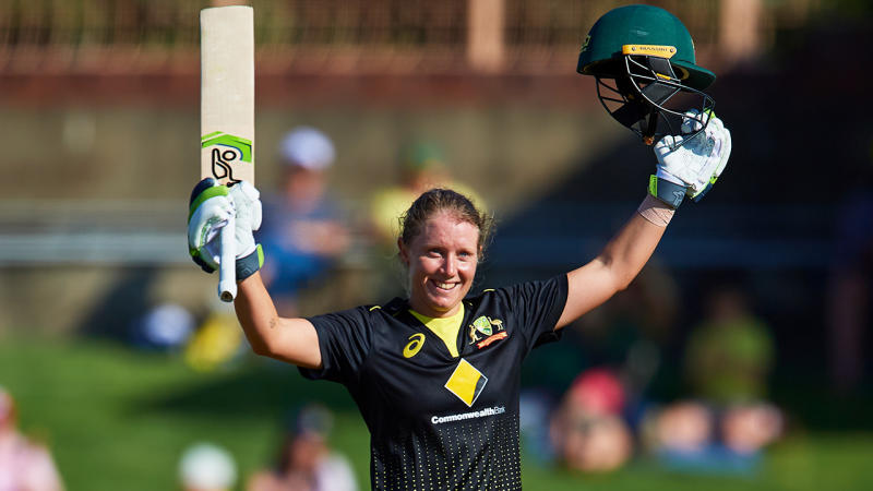 Alyssa Healy celebrates after scoring a century at North Sydney Oval.
