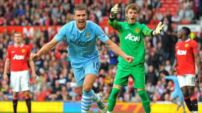 Manchester United menelan kekalahan telak 1-6 dari Manchester City dalam pertandingan yang berlangsung di Old Trafford, 23 Oktober 2011. (AFP/Andrew Yates)