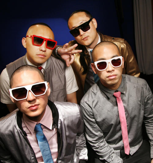 "FILE - In a Tuesday, Oct. 12, 2010 file photo, the band ""Far East Movement"" clockwise from top left, Prohgress, J-Splif, DJ Virman and Kev Nish, pose for a portrait in New York. The group's latest album, ""Dirty Bass,"" is set for release on June 5, 2012. (AP Photo/Jeff Christensen, File)"