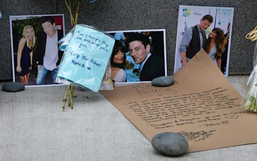 Photographs and notes are placed at a memorial for Canadian actor Cory Monteith outside the Fairmont Pacific Rim Hotel in Vancouver, British Columbia on Monday July 15, 2013. Monteith, 31, was found dead in his room at the hotel on Saturday, according to police, who have ruled out foul play. (AP Photo/The Canadian Press, Darryl Dyck)